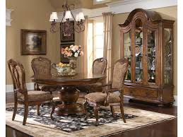 largo traviata 5 piece round dining table set olinde s furniture shown with curio china cabinet