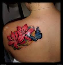 flowers and butterfly on shoulder tattoomagz