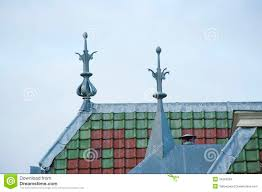 roof top with ornaments and green brown tiles stock photo image
