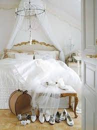 shabby chic bedrooms with chandelier and white bedding and