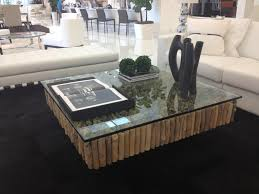 love the artefacto wood and glass coffee table living room