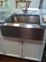 decorating silver apron sink on white cabinet with countertop for