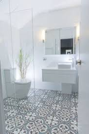 modern hexagon and subway tile shower with a muted spanish