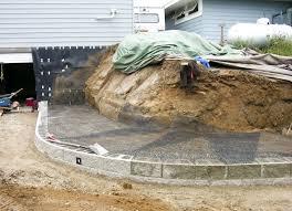 a modular block retaining wall reshapes a sloping backyard