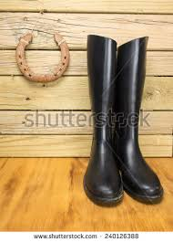 dirty riding boots dirty riding boots against stable wall stock photo royalty free
