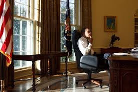 obama at desk file barack obama thinking first day in the oval office jpg