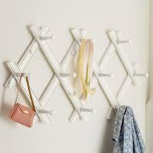 playroom for dresses accordian peg rack white in shelves