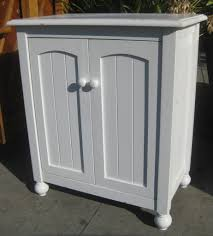white painted plywood small cabinet with swing doors using rounded