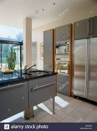 kitchen central island sink set in central island unit in contemporary kitchen with large