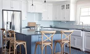 white beach bungalow kitchen with navy blue tolix stools cottage