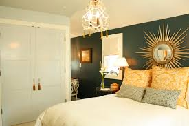 White Bedroom Throw Pillows Bedroom Accent Wall Plus Sunburst Mirrors In Master Bedroom With
