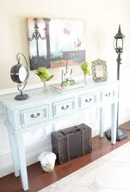 Foyer Table Decor Ideas by Classic Foyer Decorating With White Rug On Wooden Flooring And