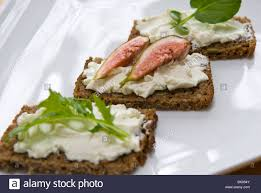 rye bread canapes pumpernickel rye bread canapes on a white plate stock photo