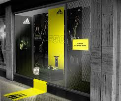 expand the display outside of the frame adidas window display