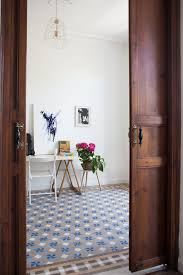 a renovated spanish home with a stunnig tile floor the style files