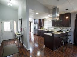 grey kitchen cabinets with brown wood floors the pros and cons of laminate flooring diy