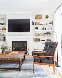 Amber Interior Design by How To Layer Rugs
