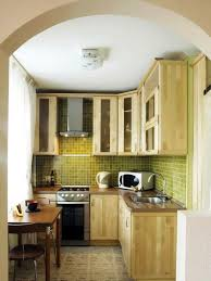tiny l shaped kitchen design floating shelf blue painted wall