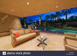 outdoor sitting area night time view of outdoor sitting area of patio with large pool