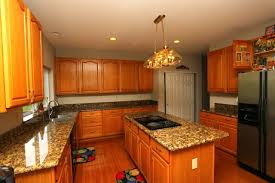 what color granite goes with golden oak cabinets oak cabinets and granite yes they blend flawlessly