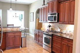 interior solutions kitchens fabuwood cabinetry wellington door style cinnamon glaze raised