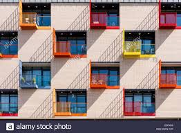 colurful windows and small balconies of modern apartment building