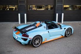 porsche 918 front of 2 gulf liveried porsche 918 spyder up for sale