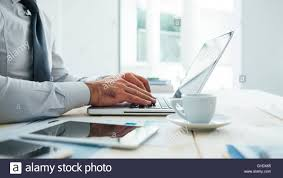 professional businessman working at office desk and typing on a
