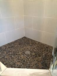 plenteous glazed grey stone pebble shower floor with white ceramic wall tile as decorating small shower room designs ideas