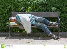 homeless man sleeping on a bench editorial stock photo image