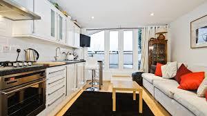 beautiful studio apartment furniture with white kitchen cabinet
