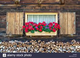 traditional window decoration in austria stock photos