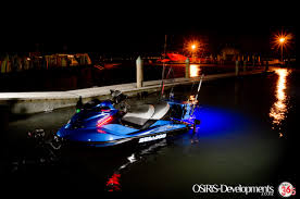 blue led rib light in the drain bung of a jetski kitted out for