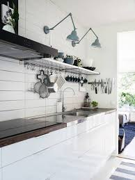 over the sink kitchen light swing arm light fixtures light blue color over open shelves and