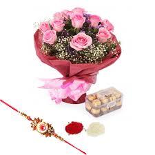 a dozen roses a dozen roses with a box of ferrero rocher chocolates and a rakhi