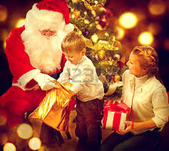 santa claus giving christmas gifts to children christmas holiday