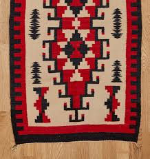 two gray hills pattern navajo rug in red and black rejuvenation