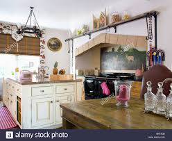 traditional country kitchen with cream island unit and oak table