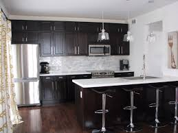 wood countertops kitchen with dark cabinets lighting flooring sink
