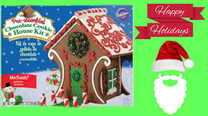 decorating a gingerbread house well really a chocolate cookie