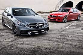 bmw vs mercedes 2014 mercedes e63 amg s vs bmw m5 competition pack motor trend