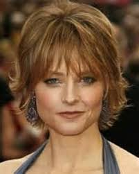 short haircuts for women over 50 with long faces storage