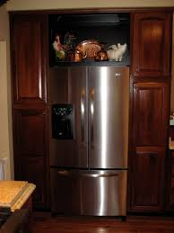 open shelves or glass cabinet over the refrigerator