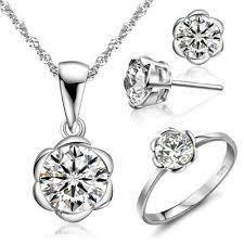 studded earrings sparkling h a swiss diamond studded plum flower pendant stud