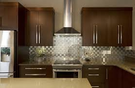 stainless steel backsplash white cabinets cream mosaic counte