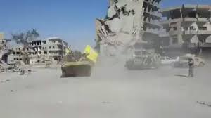 how do they celebrate victory in raqqa with donuts of course