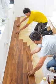 How To Lay Laminate Hardwood Flooring Floating Hardwood Floor Step 6 Magnum Red Oak Natural Queen