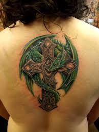vivid colors celtic cross with dragon tattoo on half sleeve