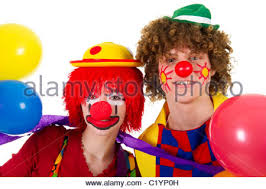 clowns balloons boy and girl dressed as clowns standing on stage with curtain