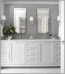 white tile backsplash with gray grout